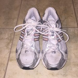 Adidas women's silver and pink running sneakers.